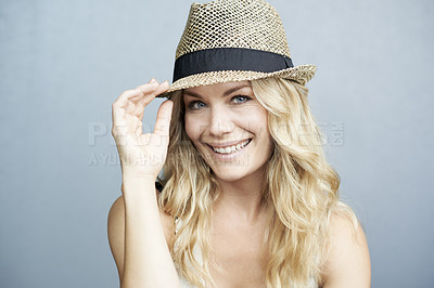 Buy stock photo Studio portrait of a gorgeous young blonde woman wearing a hat