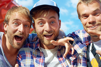 Buy stock photo Portrait of three happy guys enjoying themselves at an outdoor festival