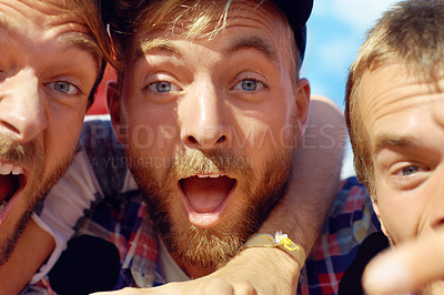 Buy stock photo Cropped shot of three happy guys enjoying themselves at an outdoor festival