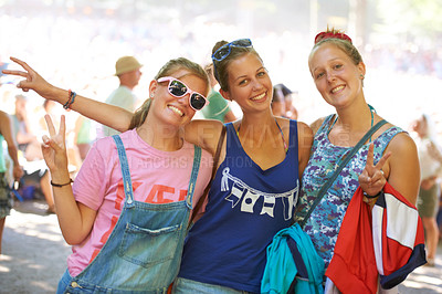 Buy stock photo Cropped shot of a group of young friends at an outdoor festival