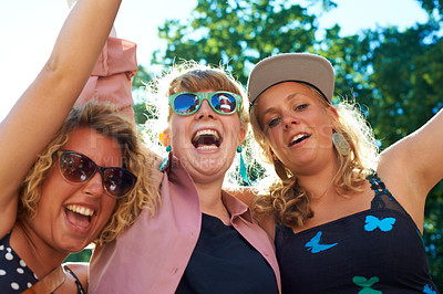 Buy stock photo A group of young women having fun at an outdoor festival