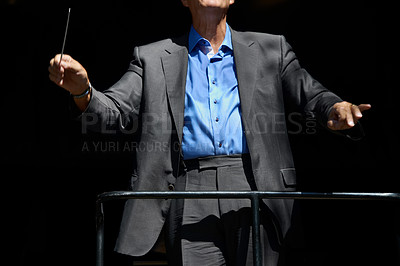 Buy stock photo Cropped view of an orchestra conductor holding his baton