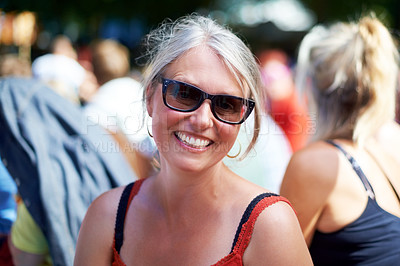 Buy stock photo Portrait of a woman enjoying herself at an outdoor festival