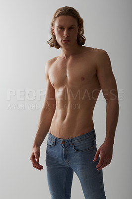 Buy stock photo Studio shot of a young man with a bare chest