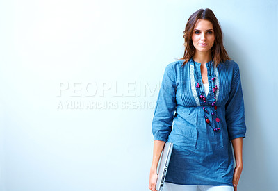 Buy stock photo Pretty young woman standing with a laptop