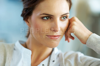 Buy stock photo Closeup of a thoughtful young woman looking away