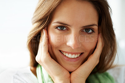 Buy stock photo Young woman smiling with her hand on cheeks