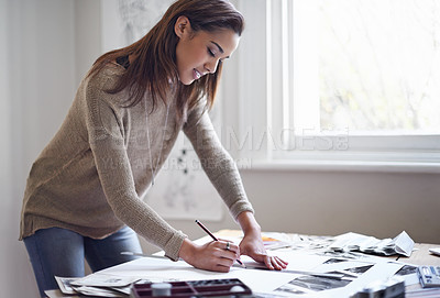 Buy stock photo A young woman working on her portfolio at home