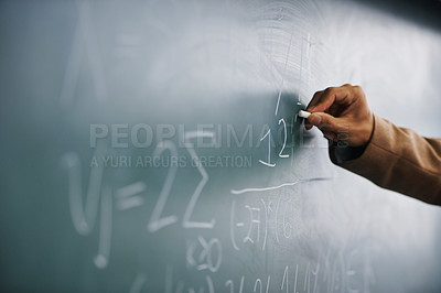 Buy stock photo Cropped image of a teacher writing a formula on a blackboard