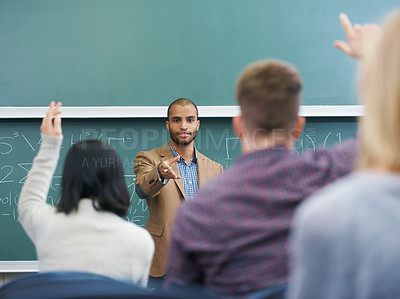 Buy stock photo Cropped shot of a lecturer addressing his students