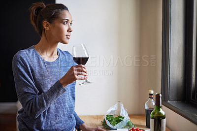 Buy stock photo A young woman drinking some red wine
