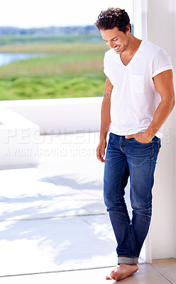 Buy stock photo Shot of a handsome man standing outside of his house