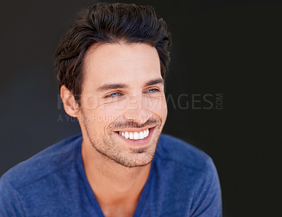 Buy stock photo Shot of a handsome smiling man