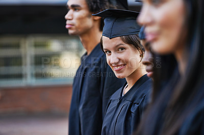 Buy stock photo A college graduate smiling during her graduation ceremony
