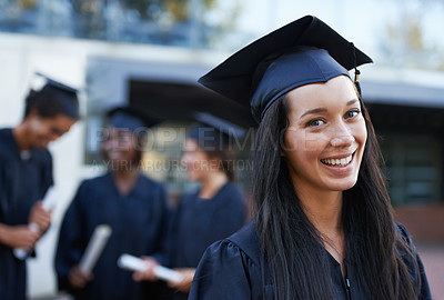 Buy stock photo A young college graduate smiling at the camera