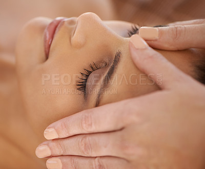 Buy stock photo A young woman enjoying a head and face massage at a spa
