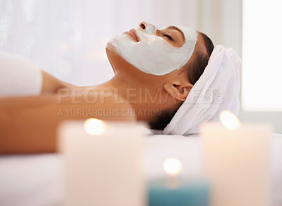 Buy stock photo Shot of a young woman enjoying a facial treatment at a spa