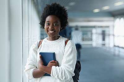 Buy stock photo Portrait of a confident young african american student standing in a college hallway