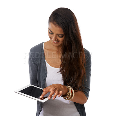 Buy stock photo A young ethnic woman working on her digital tablet