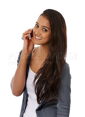 Buy stock photo An ethnic woman speaking on her cellphone while smiling at the camera