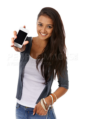 Buy stock photo A young ethnic woman holding showing her smartphone to the camera