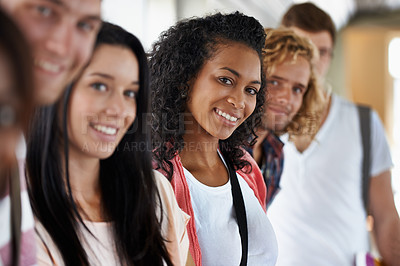 Buy stock photo Portrait of a beautiful young college student standing with her friends