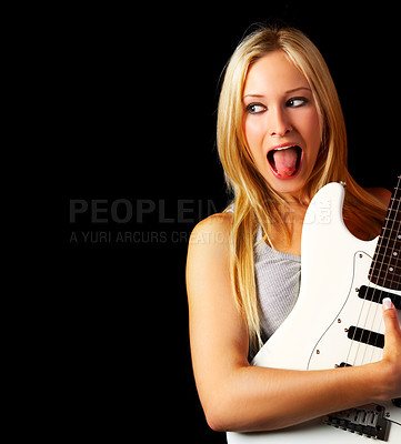 Buy stock photo Studio shot of a gorgeous female guitar player isolated on black