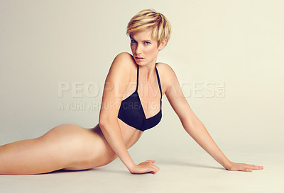 Buy stock photo Studio shot of a confident young woman posing in her underwear