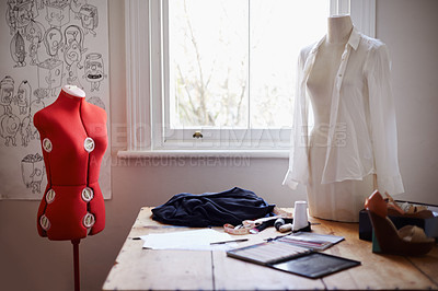 Buy stock photo Shot of a clothing designers office