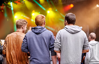 Buy stock photo Rearview shot of a crowd at a concert with light effects