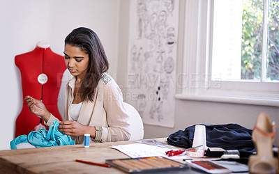 Buy stock photo A seamstress taking measurements for a garment she's making