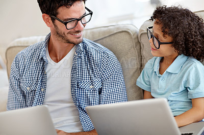 Buy stock photo A little boy and his father working on laptops