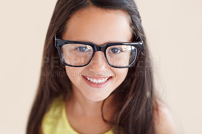 Buy stock photo Closeup portrait of a cute young girl wearing big glasses