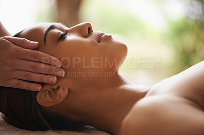Buy stock photo Shot of a beautiful young woman getting a head massage at a spa