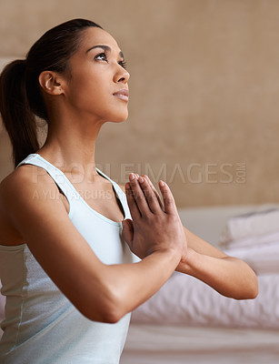 Buy stock photo An attractive young woman practicing the art of meditation