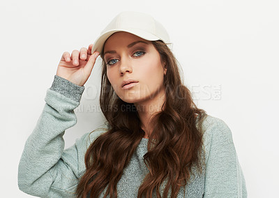 Buy stock photo Studio portrait of a young woman wearing urban fashion against a gray background
