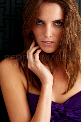 Buy stock photo Closeup portrait of an attractive young woman looking alluringly at the camera