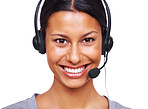 Female call centre employee wearing a headset against white