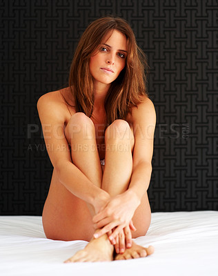 Buy stock photo Sexy young naked woman sitting on the bed