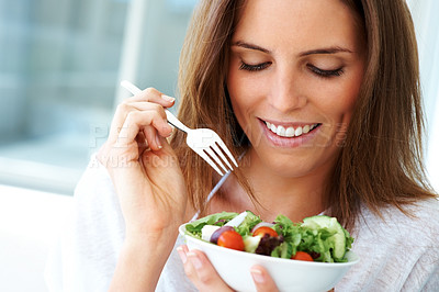 Buy stock photo Happy young lady eating vegetable salad