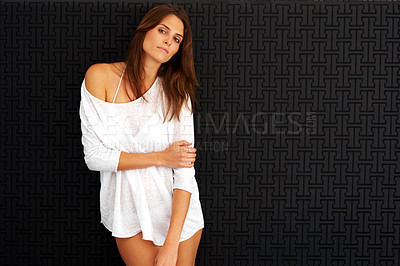 Buy stock photo Sexy young woman posing against black background