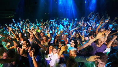 Buy stock photo Shot of a large crowd at a music concert