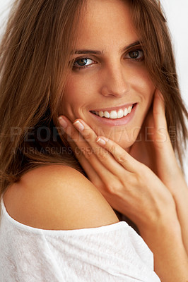 Buy stock photo Charming young female with her hand on cheek
