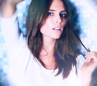 Buy stock photo Stunning young fashion model posing seductively at a club