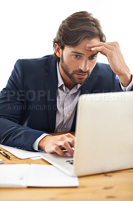Buy stock photo A handsome businessman focused on his laptop
