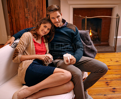 Buy stock photo A young couple relaxing together in their living room