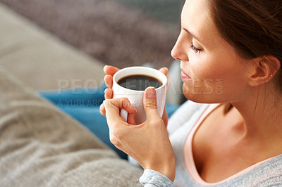 Buy stock photo Relaxed young lady enjoying a cup of black coffee