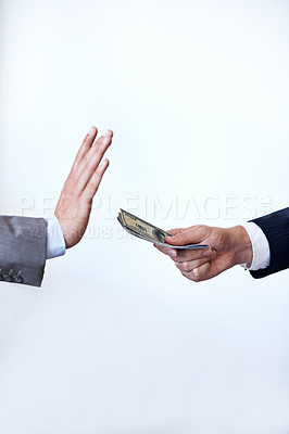 Buy stock photo Cropped shot of a businessman refusing a bribe that's been offered to him