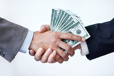 Buy stock photo Studio shot of two men shaking hands after making a monetary deal