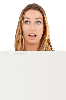 Buy stock photo Studio shot of a surprised-looking woman holding a blank sign isolated on white